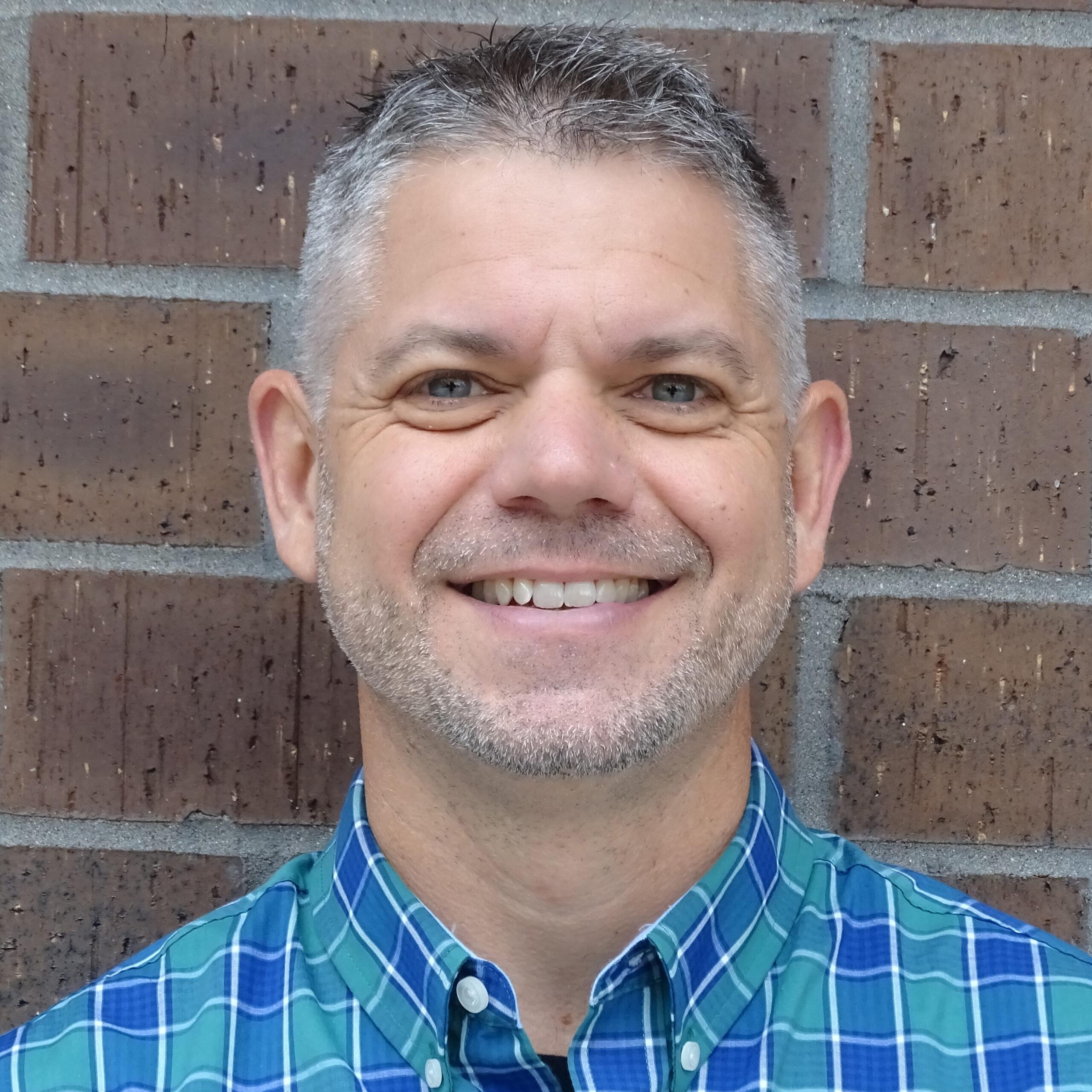 Banyan staff member Dan smiling at camera - portrait